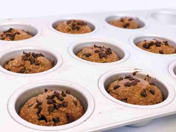 Oatmeal Chocolate Protein Muffins Lined Up In A Tray