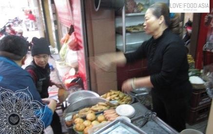 A woman preaparing Banh Goi in Hanoi