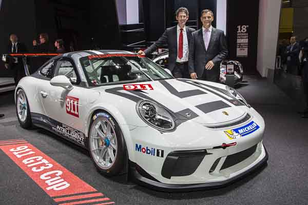 Paris Motor Show 2016: Frank-Steffen Walliser, Vice President Motorsports and GT cars, and Michael Steiner, Member of the Executive Board of Porsche AG Research and Development, at the world premiere of the new 911 GT3 Cup