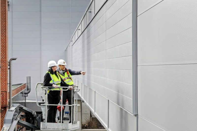 Porsche tests NOx-absorbing surface technology on the facade of the new factory built for production of the Taycan