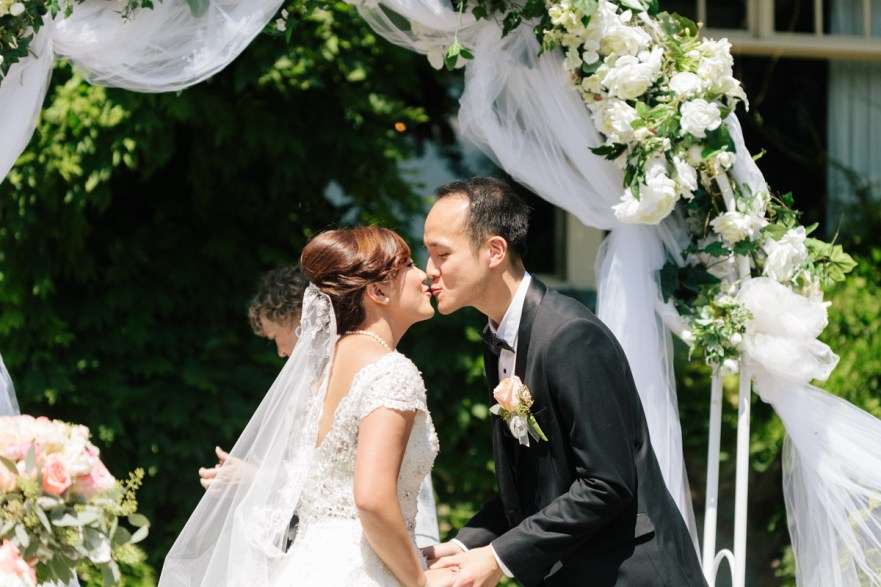 First kiss of the bride and groom (alternative angle)
