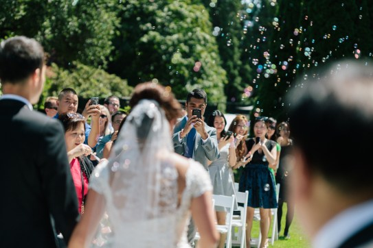 Guests taking photograph in the wedding ceremony