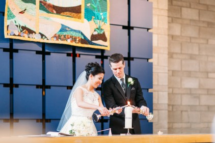 Bride and groom lighting the unity candle (Shaughnessy United Church)