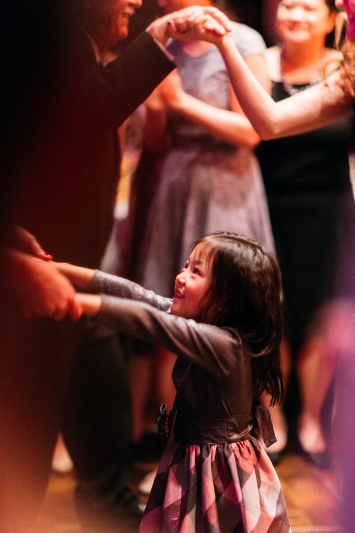 Little girl dancing in wedding banquet