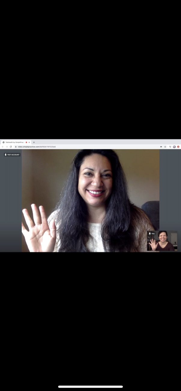 An online therapist waves at her client over teletherapy. We offer online therapy in California, online grief counseling, and other services. Contact an online therapist today for support.