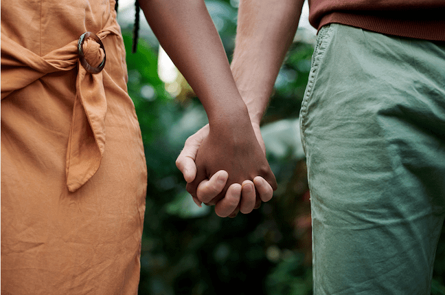 photo of a couple's hands joined together representing the beauty of couples therapy and marriage counseling in Sacramento, CA at Love Heal Grow