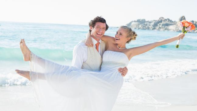 bride and groom on a beach