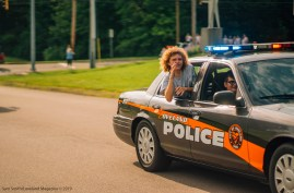 The McAnich Twins ride in the back of a police car