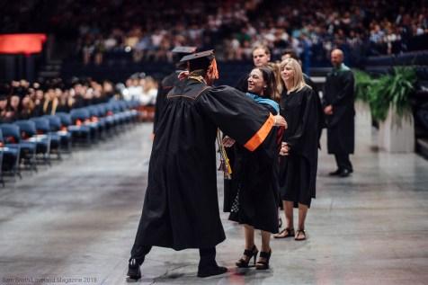 Teacher Jennifer Chast hugs a student