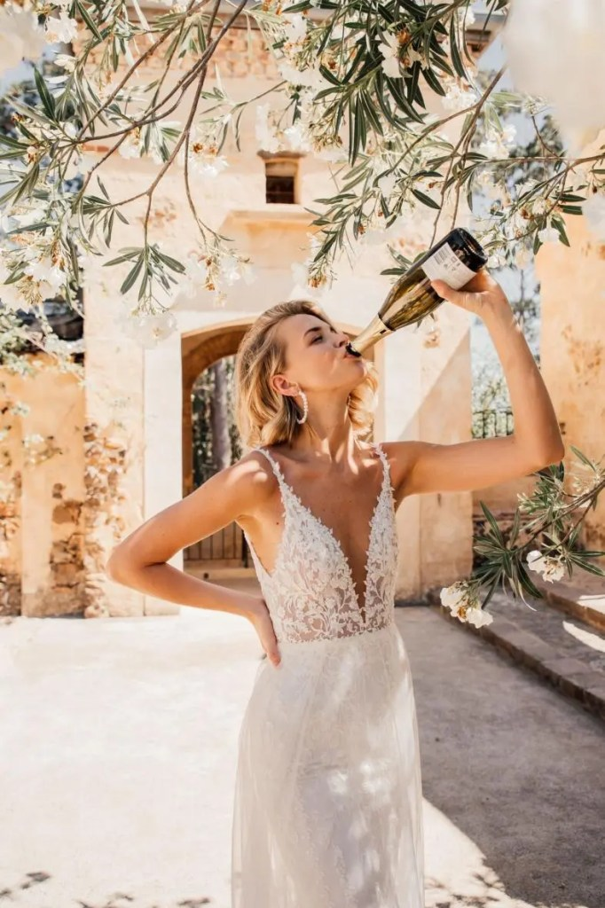 summer bride drinking champagne by Made with Love bridal