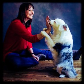 An owner with her dog poseing for pictures.
