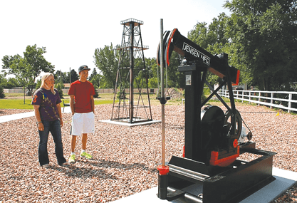 Bonnie Bates and AJ Dickson check out the new Marathon Oil exhibit at the Byron Memorial Park recently. The park, which honors Byron's history and military veterans, is now complete for all to enjoy. Bob Rodriguez photo