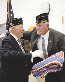 """Veteran Terry Wilkerson presents a """"Quilt of Valor"""" to his uncle Frank Wilkerson, during a special event held at the North Big Horn Senior Center on Tuesday, honoring veterans in the community. Patti Carpenter photo"""