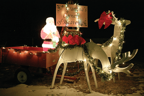 Grandma's Corner of Heaven, located at the corner of Main Street and South Third Street East in Cowley, took third place for its colorful vignettes.