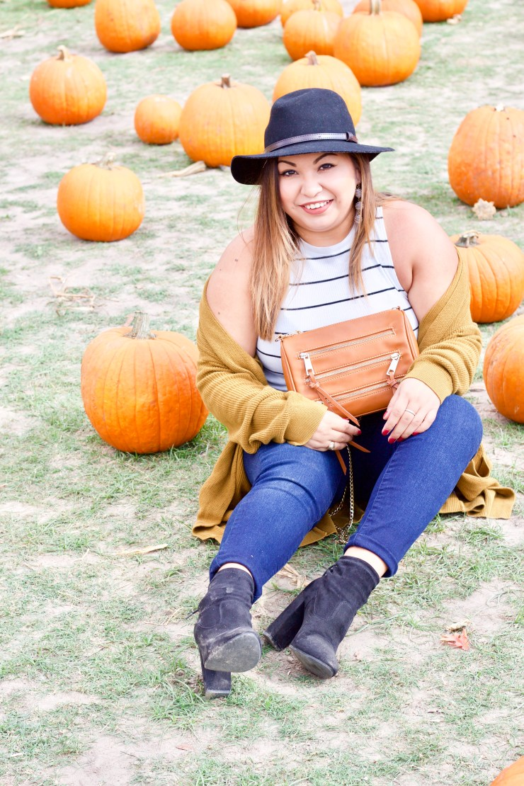 fall outfit, fall inspiration, fall look, pumpkin patch, outfits to visit pumpkin patch, fall photoshoot, yellow cardigan, mustard cardigan, striped top, outfits with black hat, black booties, cognac bag, zipper purse, brown purse