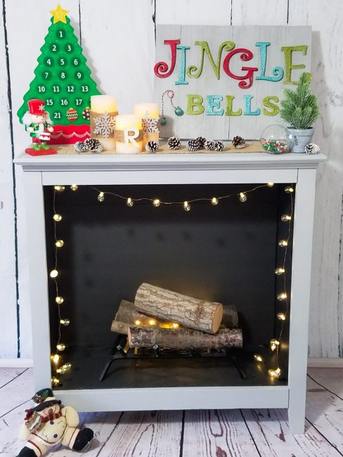 bookshelf turned into DIY faux fireplace