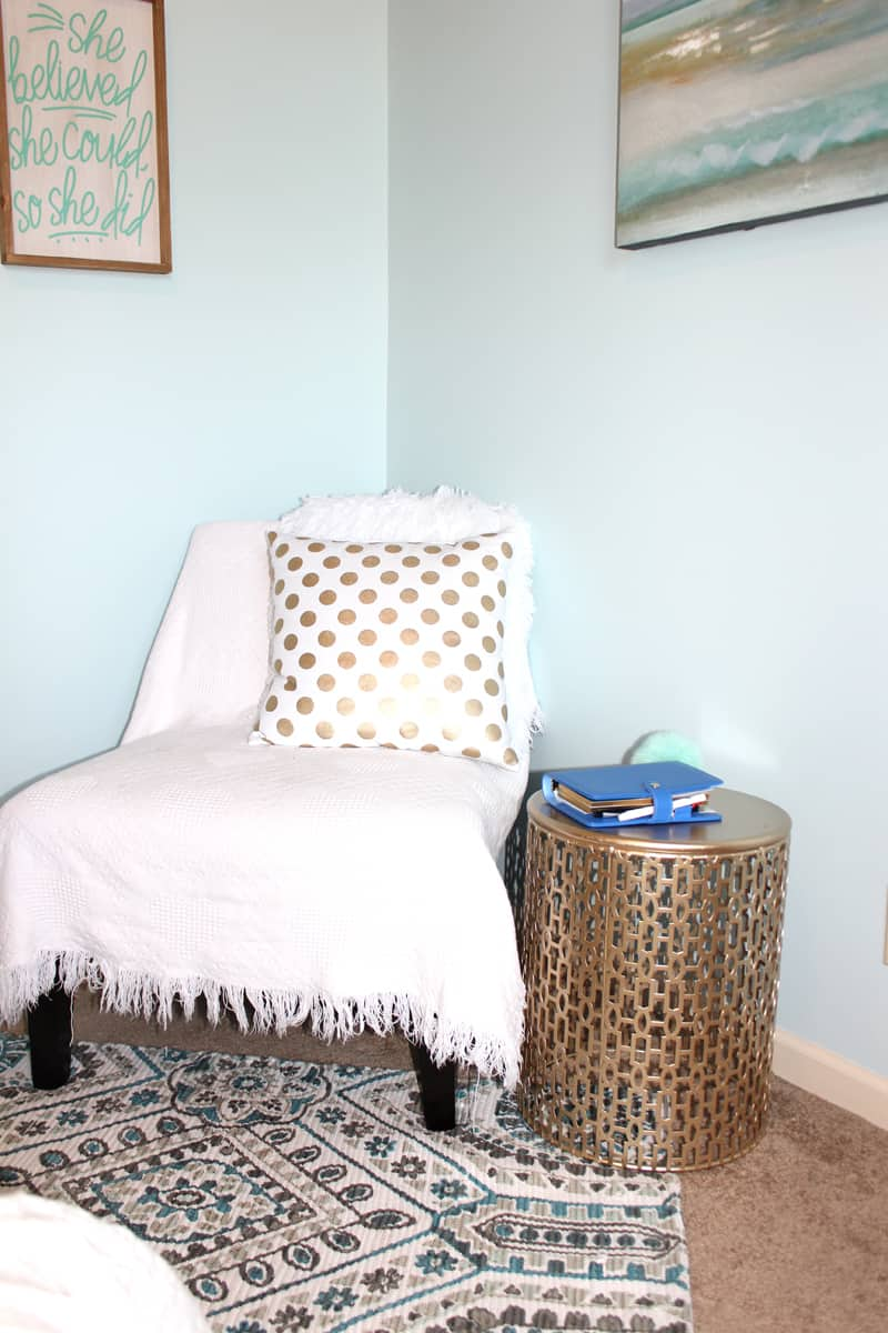 Reading nook in tween girl's bedroom, gold table, gold polka dot pillow