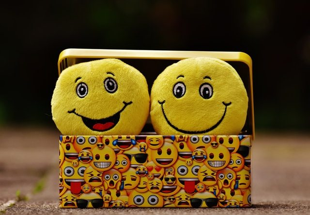 Two Yellow smiley faces laughing