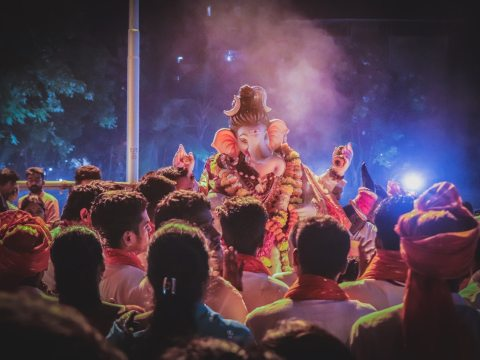 People worshiping lord ganesha