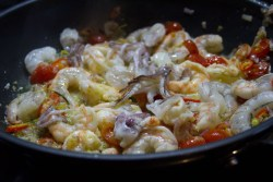 Prawn, Squid, and Chilli being simmered in a pan