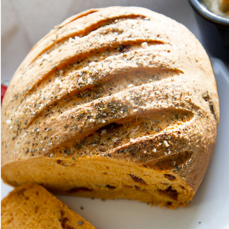 Sun-dried tomato bread with oregano and sea salt crust.