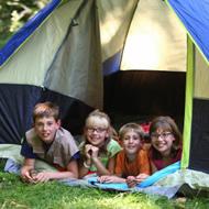 kids outside in tent