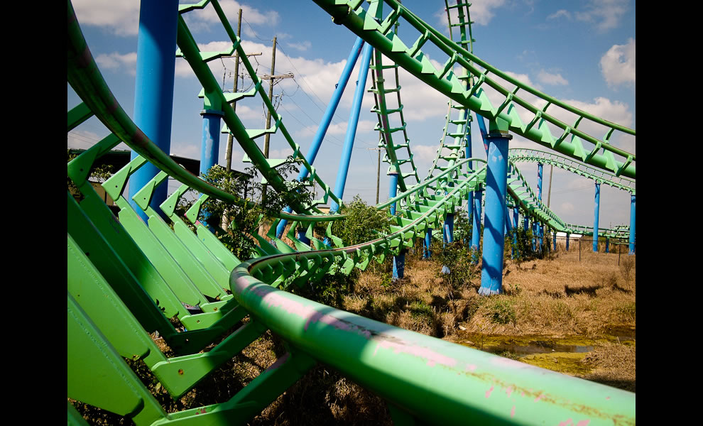 Abandoned Six Flags roller coaster - Watch out for that tree!