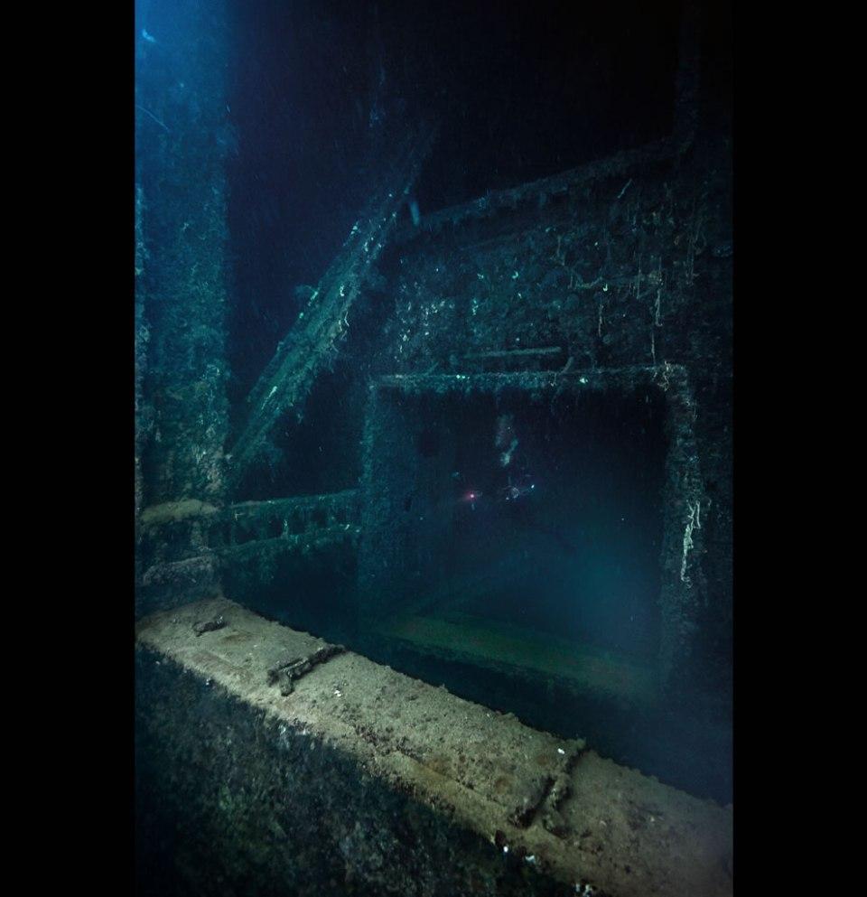 Leaving a hold of the Yamagiri Maru. Truk Lagoon, Micronesia. The wreck lies on its side.