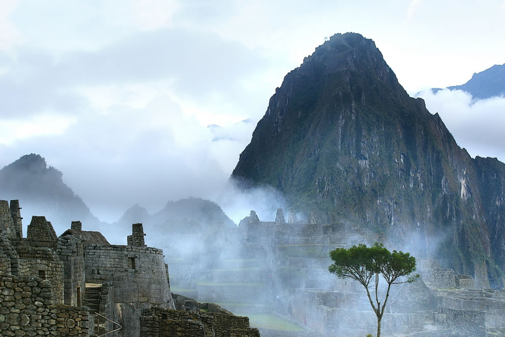ghosts in the foggy ruins of Machu Picchu