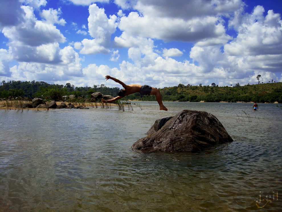 Rock jumping on a hot day as the rivers of Amazon suffer flooding for 4 or 5 months of the year
