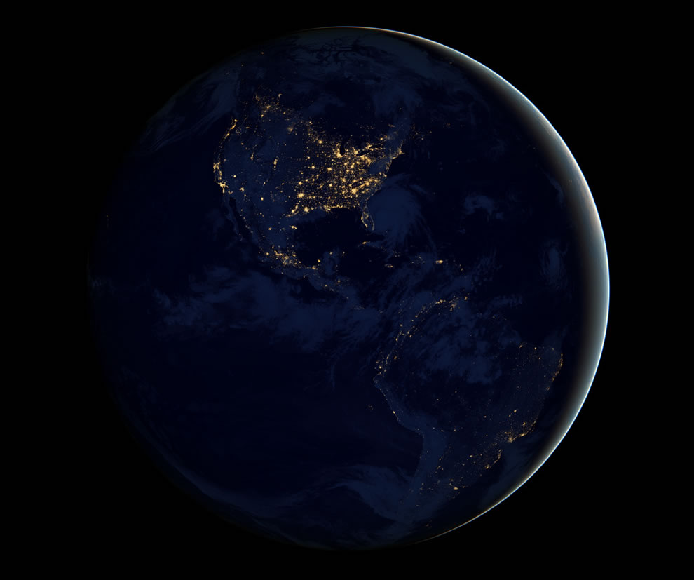 North and South America at night twinkling with light in the darkness