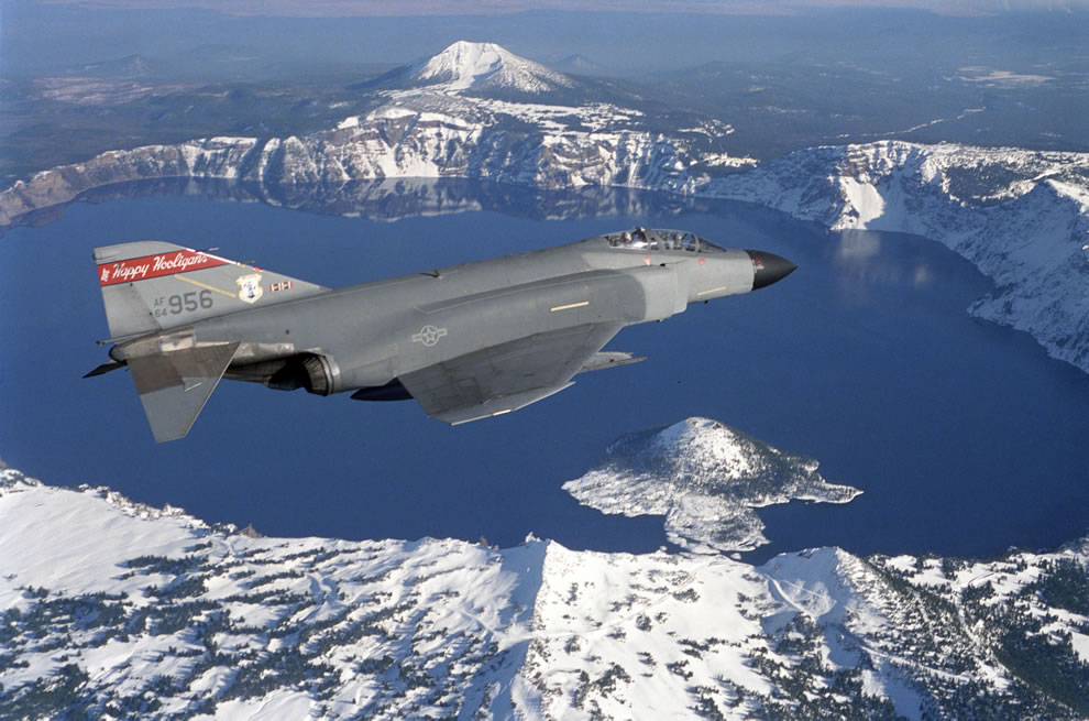 Phantom II fighter flies over Crater Lake, Oregon