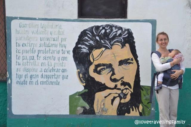 Love travelling family in front of Che mural in Santa Clara, Cuba