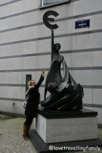 Love travelling family at Europe statue, Brussels, Belgium
