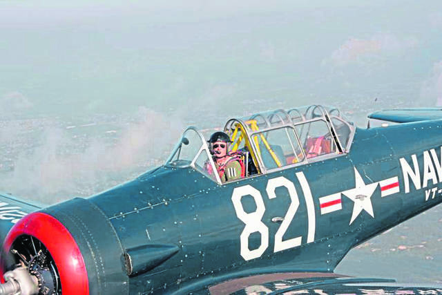 David Kahley pilots his restored T-6G World War II trainer plane during a formation training clinic conducted by the North American Trainers Association in Culpeper, Va.