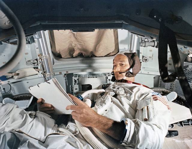 Apollo 11 Command Module pilot Michael Collins practices in a simulator on June 19, 1969, at Kennedy Space Center in Florida.