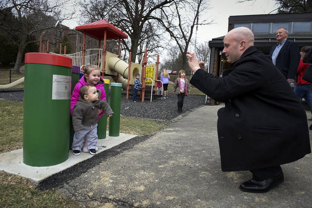 Tom Hall, husband of Jamie Cordial Hall, takes a photo of his two children Cody, 11-months, and Chloe, 4, on March 21, 2019, before the start of the dedication of a musical playgroup at Seton Hill University Child Development Center in Greensburg.