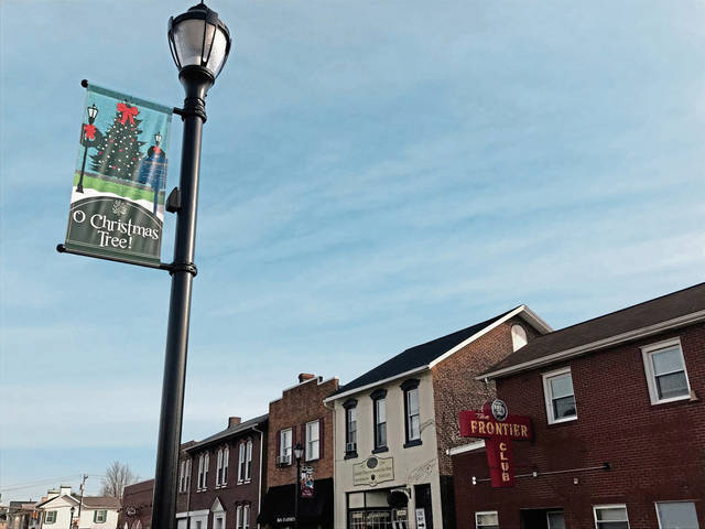 A holiday banner hangs from one of the recently installed decorative lamp posts in downtown Latrobe, along Depot Street.