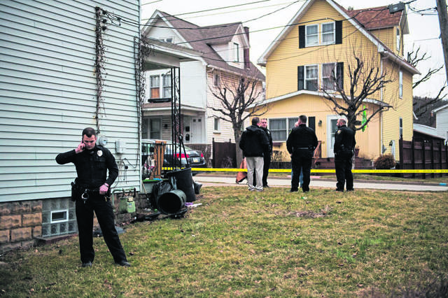 Law enforcement officials work at the scene of a police involved shooting Wednesday, March 13, 2019 on Grant Street in Greensburg. Greensburg Police opened fire on a female suspect who was armed with a handgun and shot at a vehicle on Harvey Avenue in Greensburg. The condition of the woman is unknown.