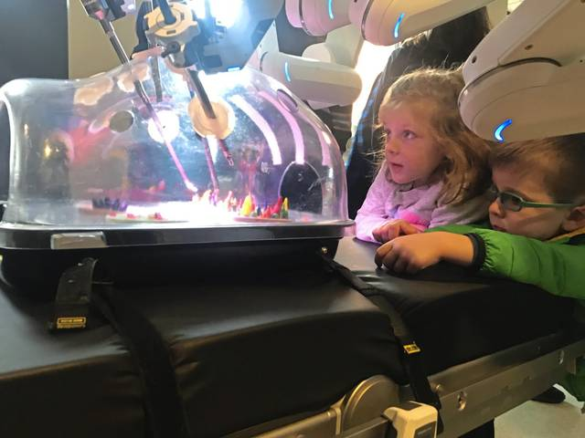 Brooklyn Mills, 5 (left), and her brother, Henry Mills, 3,of Penn Hills, get a close look at the working arms of a new da Vinci Xi surgical robot introduced during an open house on Friday, Jan. 17, 2020, at Excela Latrobe Hospital. They attended the event with their grandparents, Dr. Stephen Mills, a primary care physician at Excela Square at Latrobe, and his wife, Jan, president-elect of the Latrobe Area Hospital Aid Society.