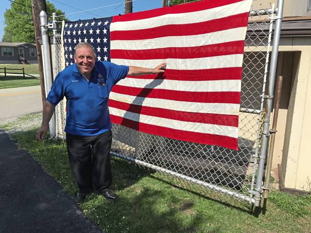 Eric Harris, of East Huntingdon opens the gate at the Evergreen Drive-in on Saturday. The drive-in, located near Mt. Pleasant, hosted a Patriotic Rosary for the local chapter of the Knights of Columbus on Independence Day.