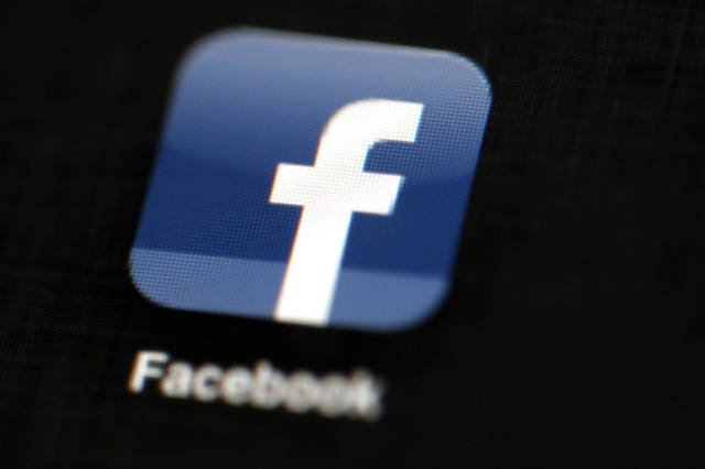 The Facebook logo displayed on an iPad.