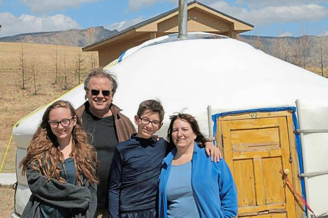 Amanda, Andy, Jeffrey and Pam Mewbourn pose outside a yurt in Mongolia in May 2016.