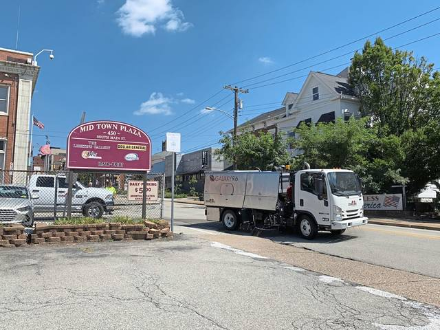 A street sweeper drives past Mid Town Plaza in Greensburg on Wednesday. The plaza will be the site of a Cops for Trump rally Thursday, which wll be attended by Vice President Mike Pence.