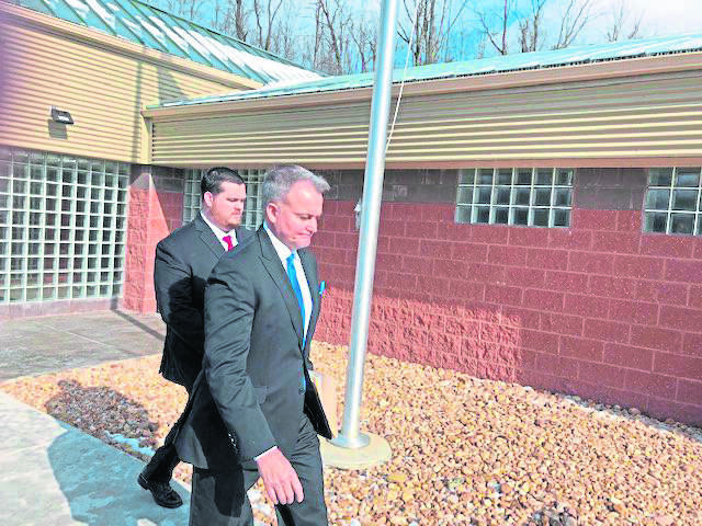 Former Westmoreland County Sheriff's Deputy Daniel A. Gradischek, 33, left, is accused of inappropriate contact with female inmates he was transporting. Gradischek is pictured leaving Hempfield District Judge Mark Mansour's office with his attorney, Michael Ferguson on Feb. 28, 2020.