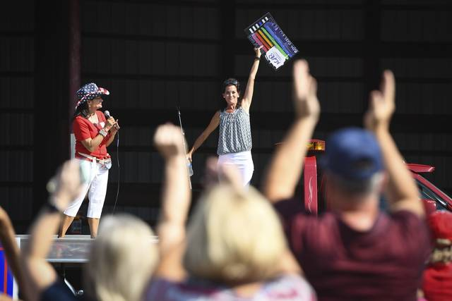 People cheer for KDKA Radio personality Wendy Bell (right) after she finishes her speech during a MAGA Meet Up event in a lot near the new Murrysville Trump Victory Office on Saturday<ins>,</ins><ins> Aug. 22, </ins><ins>2020</ins>.