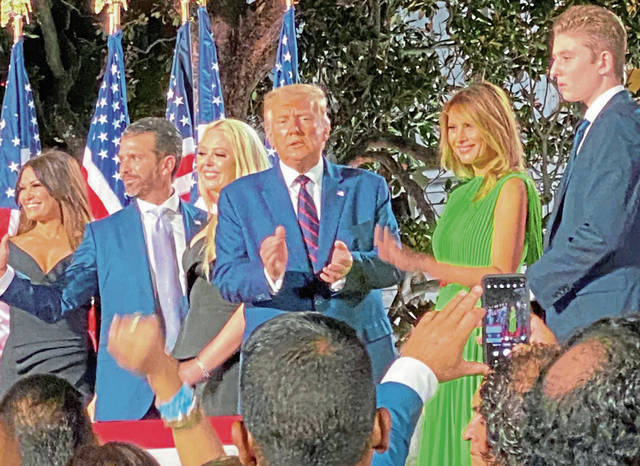 The Trumps and son Barron greet guests at the White House Thursday night as Donald Trump accepted the Republican Party nomination for a second term in office.