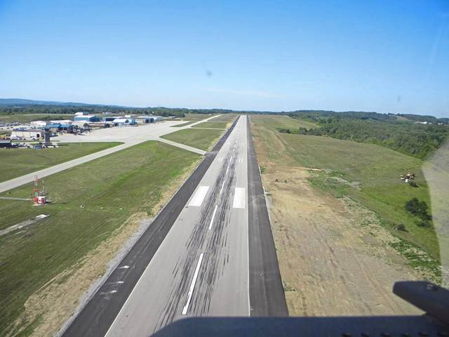 As of Aug. 11, work was about 65% complete for widening and strengthening the runway at Arnold Palmer Regional Airport in Unity. Golden Triangle Construction is expanding the runway to 150 feet in width, adding darker 25-foot strips to either edge, as seen in this aerial photo.