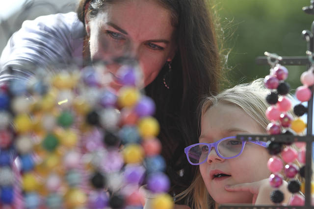 Kathleen Star of Monroeville shops for children jewelry at Ashlee's Attic with her daughter, Julianna, 4, during the Downtown Irwin Fall Craft Show in the S&T Bank parking lot Saturday<ins>, Sept 12, 2020</ins>.
