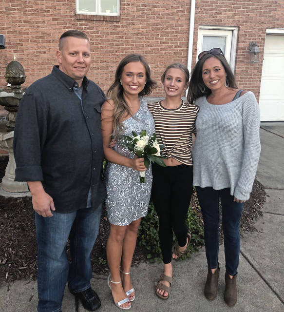 Eddie Coletta, 43, stands with his wife, Rachel, and two daugthers, Emma and Carly.